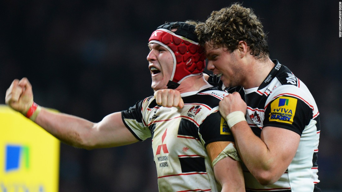 Gloucester's Rob Cook, left, celebrates Sunday, December 27, after scoring his team's fifth try during a Premiership match against Harlequins in London. The match ended in a 39-39 draw.