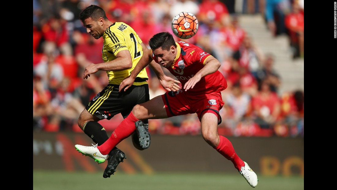 Adelaide United's Dylan McGowan, right, clears the ball in front of Wellington Phoenix's Manny Muscat during an A-League match in Adelaide, Australia, on Saturday, December 26.
