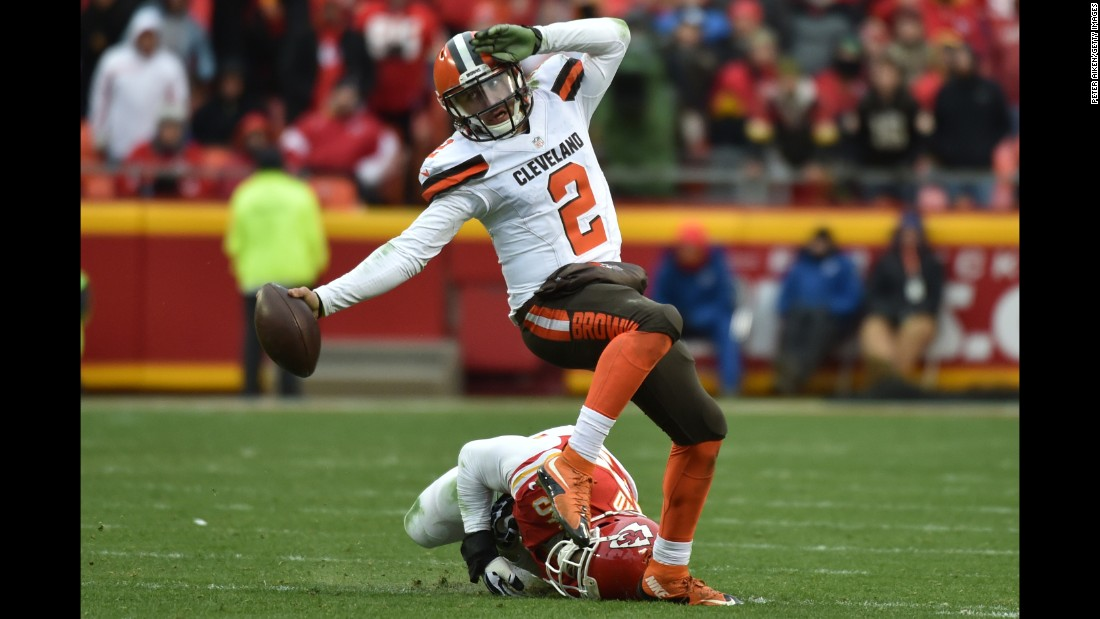 Cleveland quarterback Johnny Manziel evades a tackler during an NFL game in Kansas City, Missouri, on Sunday, December 27.