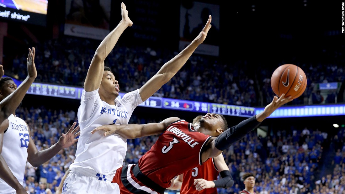 Louisville guard Trey Lewis tries to shoot the ball over Kentucky's Skal Labissière on Saturday, December 26. Kentucky defeated its in-state rival 75-73.
