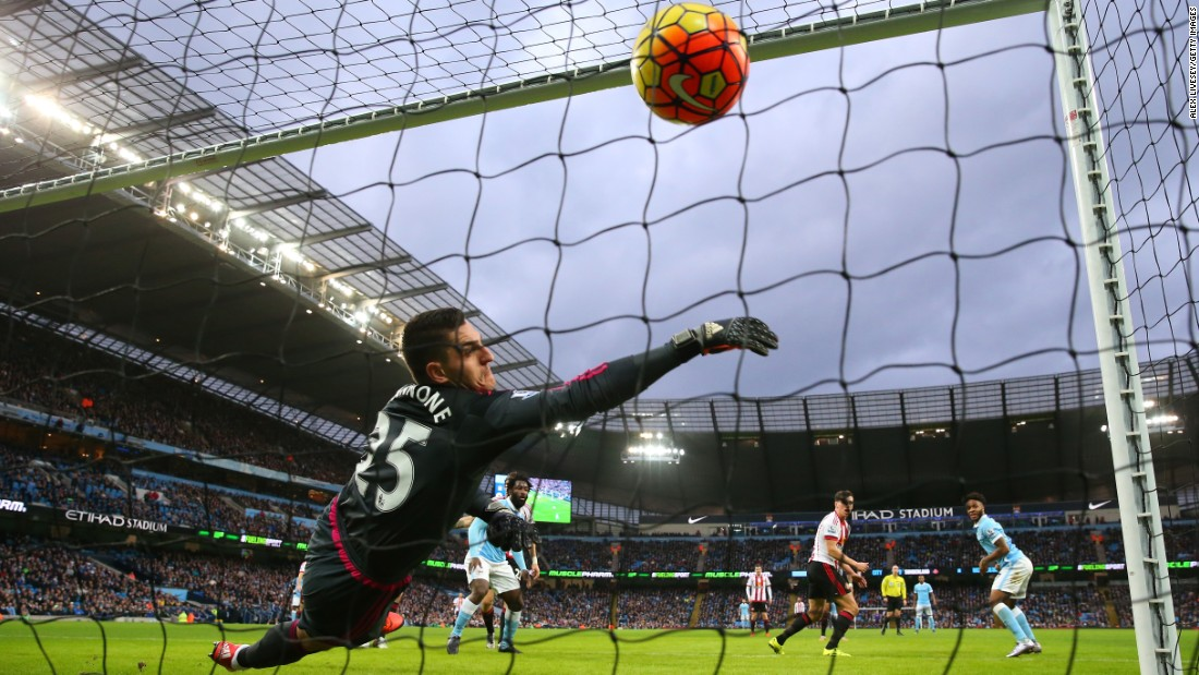 Sunderland goalkeeper Vito Mannone can't stop Manchester City's Raheem Sterling, right, from scoring the opening goal of a Premier League match Saturday, December 26, in Manchester, England. Manchester City went on to win 4-1.