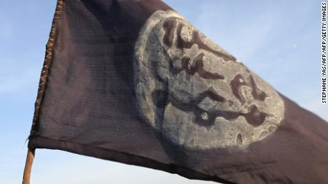 A Boko Haram flag flutters from an abandoned command post in Gamboru deserted after Chadian troops chased them from the border town on February 4, 2015. Nigerian Boko Haram fighters went on the rampage in the Cameroonian border town of Fotokol, massacring dozens of civilians and torching a mosque before being repelled by regional forces. AFP PHOTO/STEPHANE YAS        (Photo credit should read STEPHANE YAS/AFP/Getty Images)