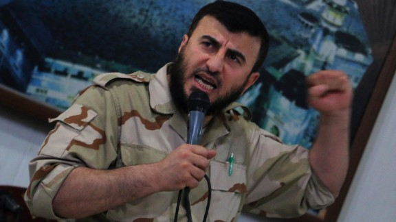 Zahran Alloush, head of the Jaish al-Islam (Islam Army) Syrian rebel group, speaks during the wedding of a fighter in the group on July 21, 2015, in the rebel-held town of Douma, on the eastern edges of the Syrian capital Damascus. Alloush, head of the powerful Jaish al-Islam Syrian rebel group, was killed along with five other commanders on December 25, 2015, east of Damascus, the Syrian Observatory for Human Rights and Syria's opposition said. AFP PHOTO / AMER ALMOHIBANY / AFP / AMER ALMOHIBANY        (Photo credit should read AMER ALMOHIBANY/AFP/Getty Images)