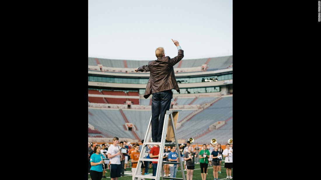 Robert Carnochan, director of The University of Texas Longhorn Band, conducts during rehearsal.
