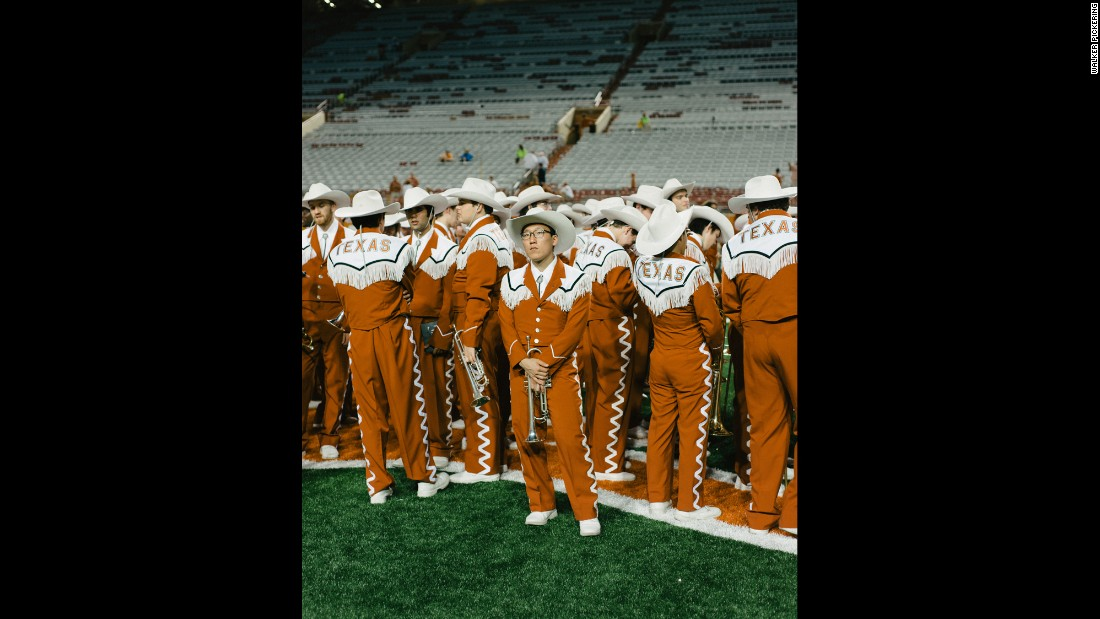 Bin Her poses with his trumpet before performing with The University of Texas Longhorn Band.