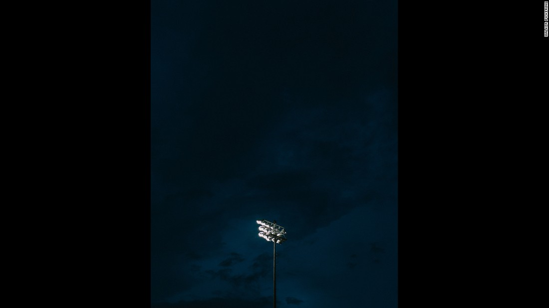 Stadium lights shine above the field at Round Rock High School's Dragon Stadium.