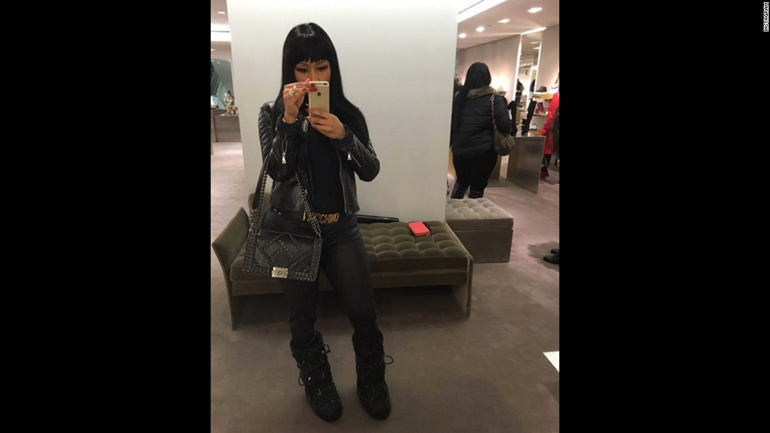 "Rapper Nicki Minaj shows off her fashion on Thursday, December 24. ""In love w/these Jimmy Choo moon boots,"" <a href=""https://www.instagram.com/p/_sRM3SL8Tf/?taken-by=nickiminaj"" target=""_blank"">she said on Instagram.</a> ""Bag by Chanel, of course."""