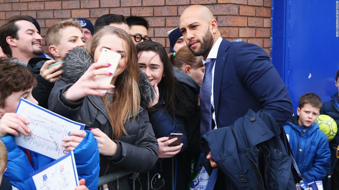 Everton goalkeeper Tim Howard poses for a fan's selfie before a Premier League match in Liverpool, England, on Monday, December 28.