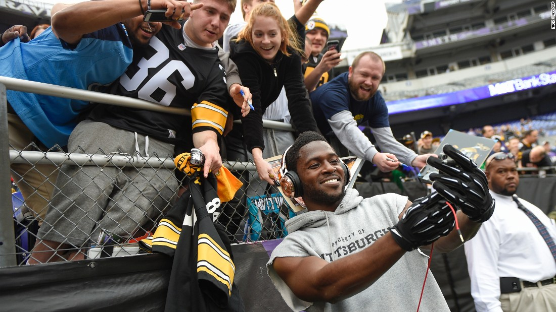Pittsburgh Steelers wide receiver Antonio Brown takes a selfie with fans before a game in Baltimore on Sunday, December 27.