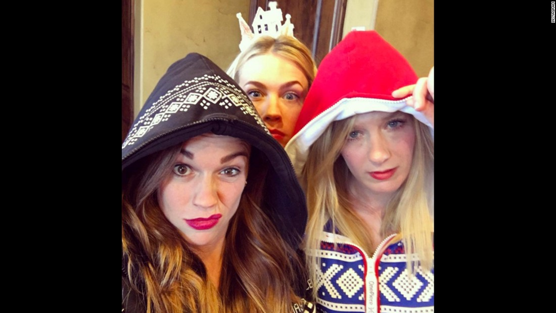 "Actress January Jones, center, pops up in a selfie with her sisters, Jina and Jacey, on Thursday, December 24. ""My sisters' punishment for not including me in their selfies is me ruining their Christmas!"" <a href=""https://www.instagram.com/p/_sEj_AitKq/?taken-by=januaryjones"" target=""_blank"">she joked on Instagram.</a>"