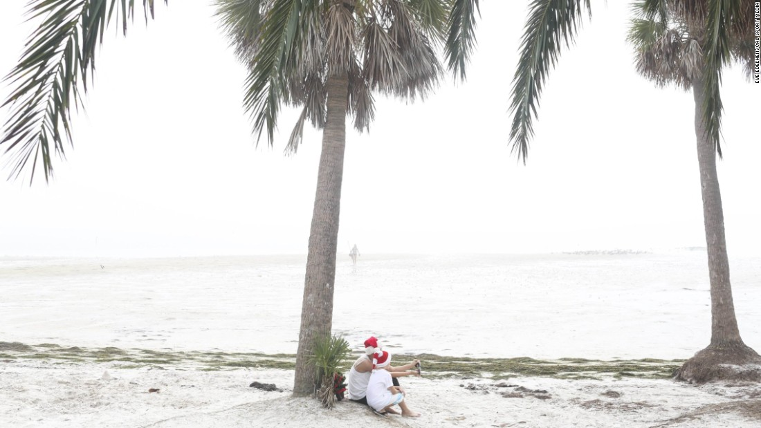 "A woman takes a selfie with her 6-year-old son as they sit on a foggy beach in St. Petersburg, Florida, on Friday, December 25. <a href=""http://www.cnn.com/2015/12/23/living/gallery/look-at-me-selfies-1223/index.html"" target=""_blank"">See 21 selfies from last week</a>"