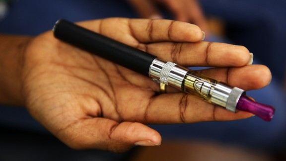NEW YORK, NY - JUNE 10: Gabrielle Ortiz holds her electronic cigarette at Vape New York, an electronic cigarette store on June 10, 2013 in New York City. Electronic cigarettes, or e-cigarettes, are battery powered devices that vaporizes a nicotine laced liquid solution into an aerosol mist which simulates the act of tobacco smoking. E-cigarettes are attracting major investors as their popularity increases and the market for traditional cigarettes continues to shrink. On Monday it was announced that Sean Parker will be investing $75 million in a leading maker of electronic cigarettes.  (Photo by Spencer Platt/Getty Images)