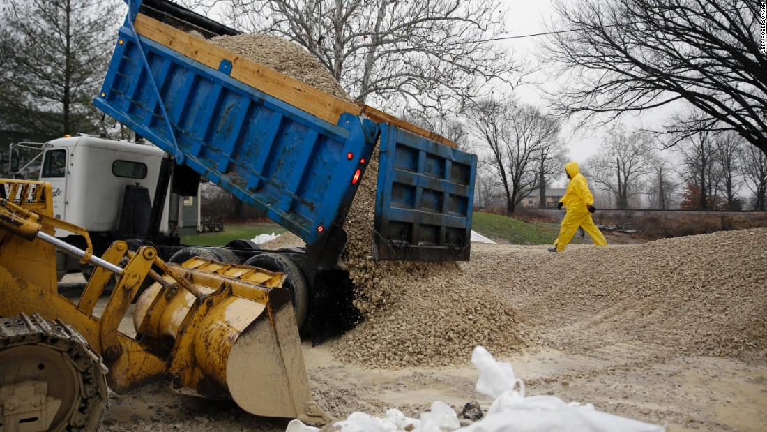 A load of gravel is dumped in an effort to hold back rising floodwaters in Kimmswick on December 28.