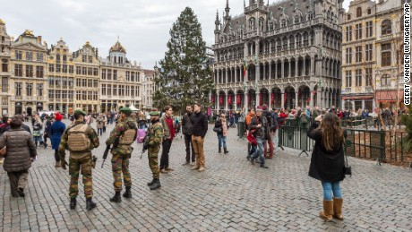 Belgian soldiers patrol Tuesday at the Grand Place in Brussels, mentioned as a possible terror target.