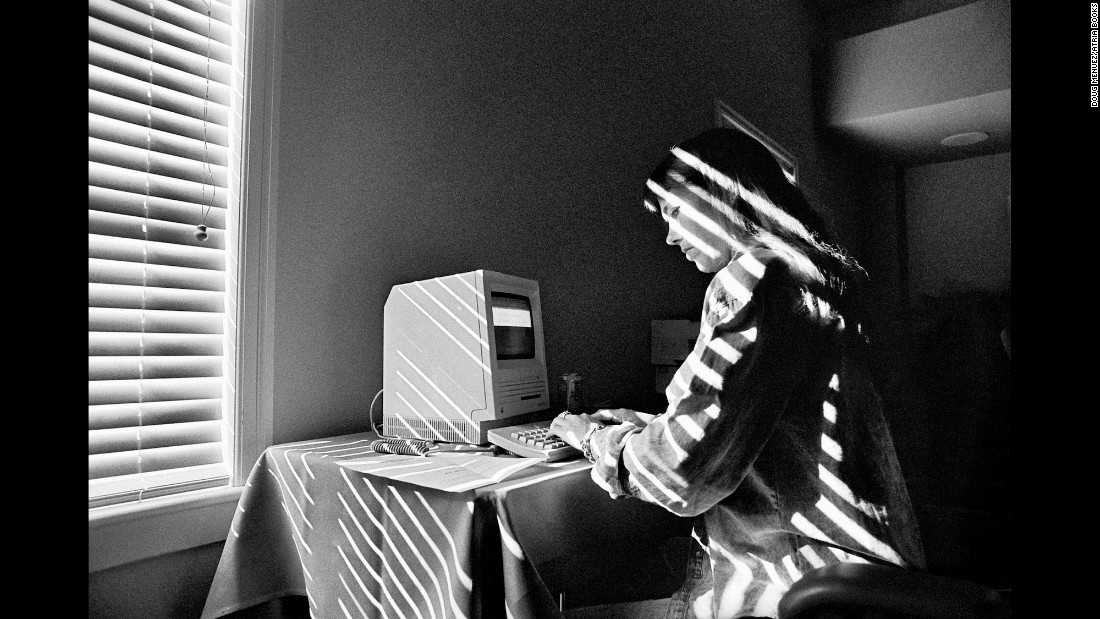 "A young NeXT employee works on an early Macintosh computer at a company retreat in 1986. ""Steve protected me,"" photographer Doug Menuez said. ""He introduced me to the company and told them to let me do what I do, because -- trust me -- it was very secretive back then just as it is now."" Menuez's work with Jobs eventually opened up access to other Silicon Valley companies such as Adobe, Intel and Microsoft, and Menuez also put those photographs in the ""Fearless Genius"" book. The title, he said, refers to all of Silicon Valley, not just Jobs."