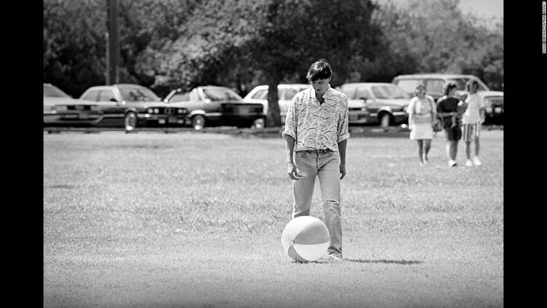 "Jobs kicks around a beach ball at a company picnic in 1987. ""Years later, he told me that I was going to have a lot of fun with these pictures someday,"" Menuez remembers. ""In fact, I think that's one of the last conversations we had in the early '90s. He was just so exciting to be around. He'd come into that building on fire every day in a great mood. He had a million ideas going. And he was inspiring, he was committed 100% and he expected everybody in that room to be on the bus to the future or, you know, get the f*** out. 'We're going to invent this thing that no one's ever done, and it's going to be really hard. How much are you willing to sacrifice? Everything? OK, good.' """