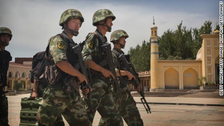 Chinese soldiers march in front of the Id Kah Mosque, China's largest, on July 31, 2014 in Kashgar, China.
