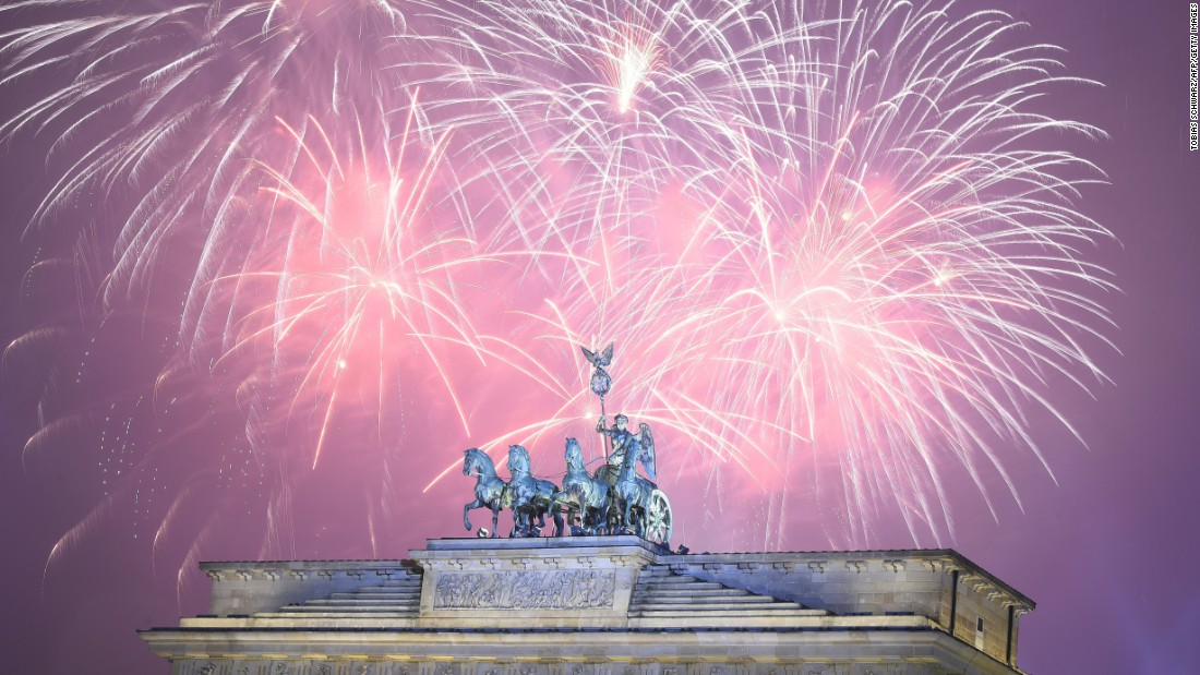 Fireworks explode at Berlin's Brandenburg Gate to usher in 2016.