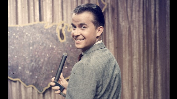 "Dick Clark, seen here in 1957, was the model of a good TV host. He readily gave up the stage and dance floor to ""American Bandstand"" visitors, oversaw ""The $10,000 Pyramid"" and its relations, and appeared on countless music and entertainment specials before he died in 2012. Seacrest co-hosted ""Dick Clark's New Year's Rockin' Eve"" with him and considered him a mentor."