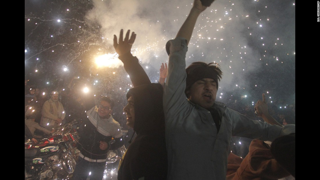 Pakistani youths celebrate the New Year in Lahore, Pakistan.