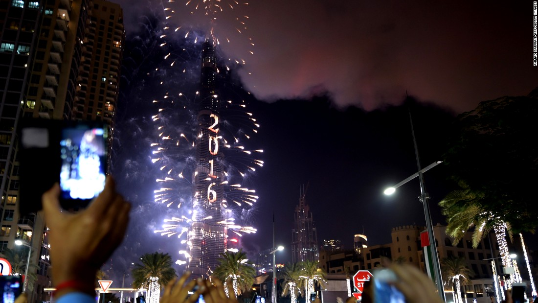 Fireworks light up the night sky near the Address hotel. Despite the fire that started hours earlier, the highly anticipated New Year's Eve festivities went ahead as planned.