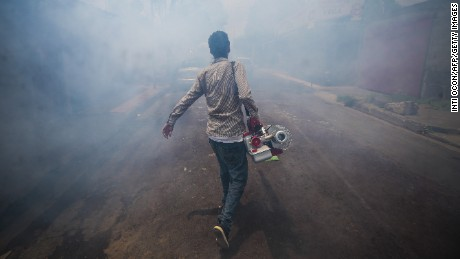 A worker of the Health Ministry fumigates against the Aedes aegypti mosquito to prevent the spread of dengue fever and chikungunya in Managua, on August 25, 2015. The Nicaraguan government issued a health alert as a dengue fever and chikungunya epidemic have killed 9 people and infected nearly 200,000 between January and August this year in Central America. Alerts have been declared in Nicaragua, El Salvador and Guatemala.