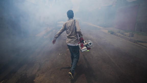 A worker fumigates against the Aedes aegypti mosquito to prevent the spread disease.
