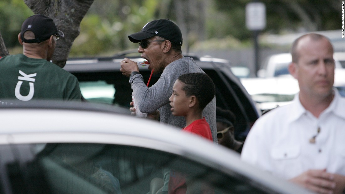 President Barack Obama eats shaved ice during his holiday vacation in Kailua, Hawaii, on Sunday, December 27.