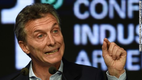 Argentinian President Mauricio Macri gestures as he speaks during the closing of a conference organized by the Argentine Industrial Union in Buenos Aires, on December 14, 2015. Argentina's new pro-business president said Monday he would end taxes on exports of industrial goods, hours after announcing large tax cuts on agricultural exports. AFP PHOTO/Eitan Abramovich / AFP / EITAN ABRAMOVICH        (Photo credit should read EITAN ABRAMOVICH/AFP/Getty Images)
