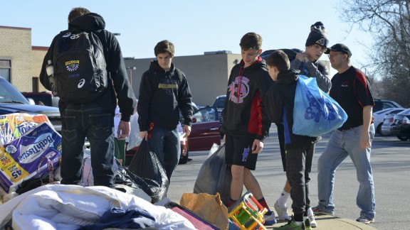 Volunteers collect donations for flood victims at Fox High School in Arnold, Missouri, on Saturday, January 2.