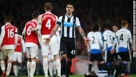 Aleksandar Mitrovic of Newcastle reacts to a missed chance against Arsenal.