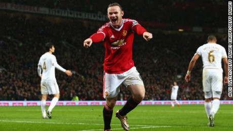 Wayne Rooney celebrates scoring Manchester United's winning goal Against Swansea.