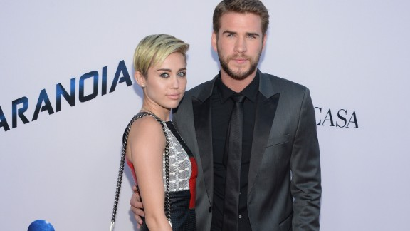 LOS ANGELES, CA - AUGUST 08:  Miley Cyrus and Liam Hemsworth attend the premiere of Relativity Media