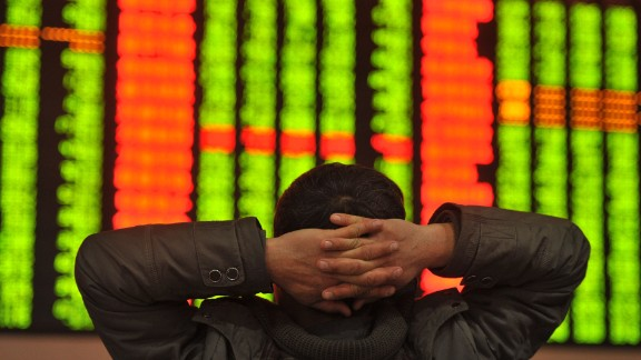"""An investor sits in front of a screen showing stock market movements in a stock firm in Fuyang, east China's Anhui province on January 4, 2016. Trading on the Shanghai and Shenzhen stock exchanges was ended early on January 4 after shares fell seven percent, the first time China's new """"circuit breaker"""" intervened to curb market volatility.        AFP PHOTO   CHINA OUTSTR/AFP/Getty Images"""