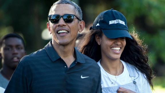 President Barack Obama and his daughter Malia Obama walk during a visit to the Honolulu Zoo on January 2, 2016, in Honolulu.