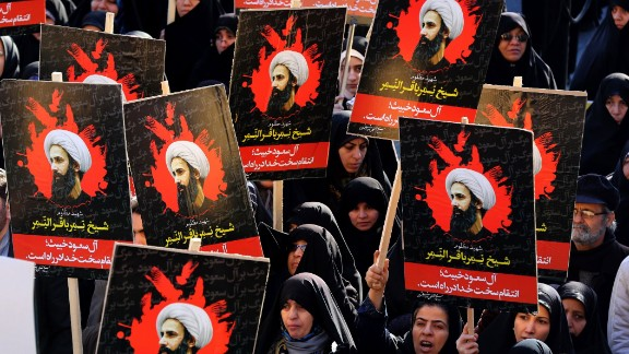 Iranian women gather during a demonstration against the execution of prominent Shiite Muslim cleric Nimr al-Nimr (portrait) by Saudi authorities, at Imam Hossein Square in the capital Tehran on January 4, 2016. Tensions between Iran and its Sunni Arab neighbours reached new heights as Saudi Arabia and Gulf allies cut or downgraded diplomatic ties with Tehran in a row over the execution of a Shiite cleric. AFP PHOTO / ATTA KENARE / AFP / ATTA KENARE        (Photo credit should read ATTA KENARE/AFP/Getty Images)