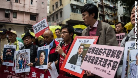 Protestors hold up missing person notices of (L-R) Mighty Current publisher of books critical of China company's general manager Lui Bo and colleagues Cheung Jiping, Gui Minhai, Lee Bo and Lam Wing-kei as they walk towards China's Liaison Office in Hong Kong on January 3, 2016. Five missing Hong Kong booksellers were rumoured to have been planning a book about Chinese President Xi Jinping's relationship with a former girlfriend, one of the city's lawmakers said on January 3, as protesters gathered to voice anger over the case.  AFP PHOTO / ANTHONY WALLACE / AFP / ANTHONY WALLACE        (Photo credit should read ANTHONY WALLACE/AFP/Getty Images)
