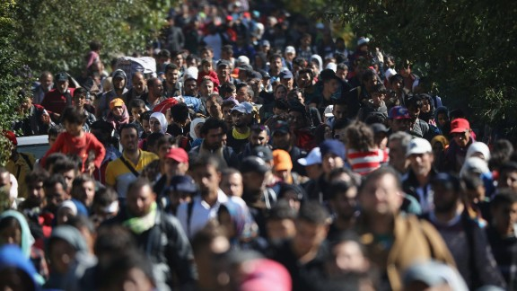 HEGYESHALOM, HUNGARY - SEPTEMBER 22:  Hundreds of migrants who arrived on the second train today at Hegyeshalom on the Hungarian and Austrian border, walk the four kilometres into Austria on September 22, 2015 in Hegyeshalom, Hungary. Thousands of migrants have arrived in Austria over the weekend with more en-route from Hungary, Croatia and Slovenia. Politicians across the European Union are holding meetings on the refugee crisis with EU leaders attending an extraordinary summit on September 23 to try and solve the crisis and the dispute of how to relocate 120,000 migrants across EU states.  (Photo by Christopher Furlong/Getty Images)
