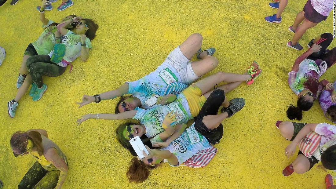 People take selfies in Pasay, Philippines, as they take part in the Color Manila Run on Sunday, January 3. The annual event encourages people to live a healthier lifestyle through physical fitness.