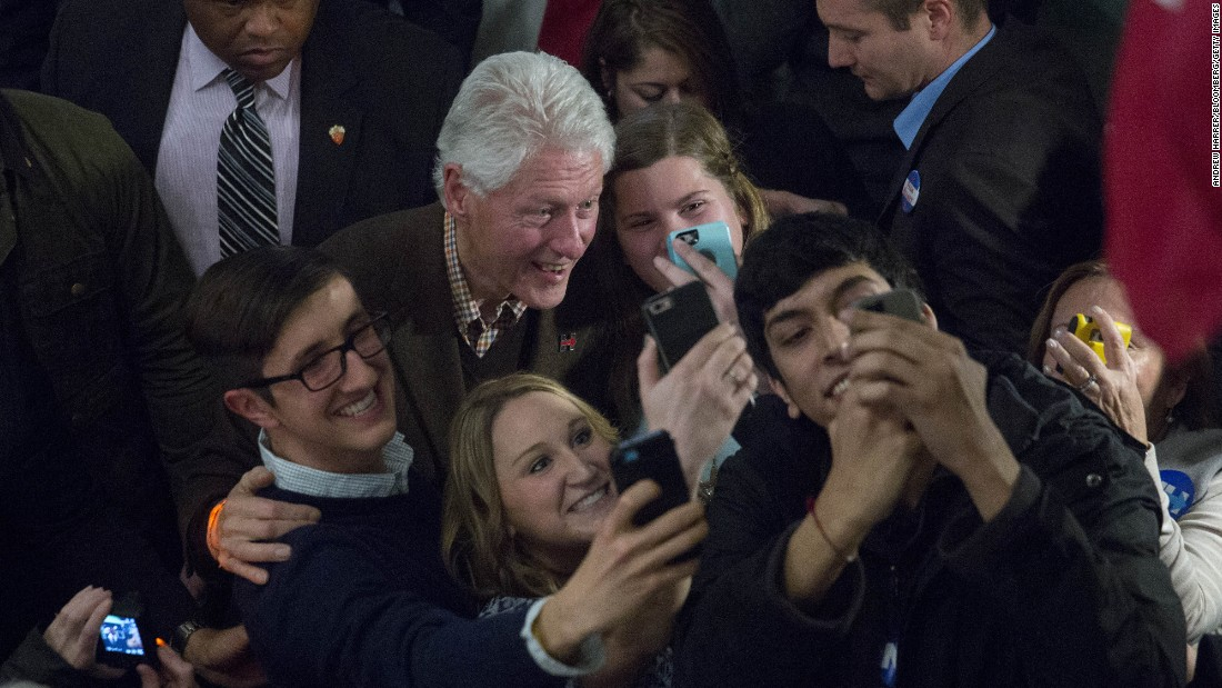 Former U.S. President Bill Clinton poses for selfies Monday, January 4, after speaking at a campaign rally for his wife in Exeter, New Hampshire. Hillary Clinton is seeking the Democratic Party's nomination for President.