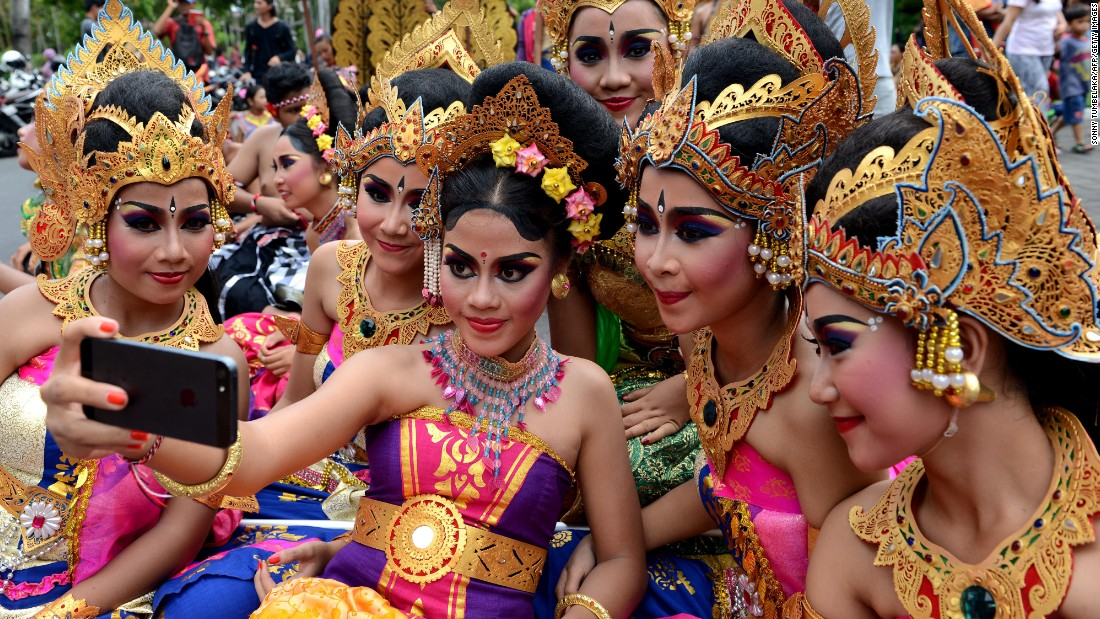 Girls take a selfie together during a New Year's celebration in Denpasar, Indonesia, on Thursday, December 31.