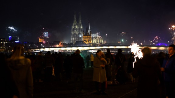 Fireworks explode over the river Rhine in front of the Cologne Cathedral during New Year's Eve celebrations in the German city.