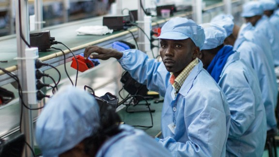 """TO GO WITH AFP STORY BY LAUDES MARTIAL MBON  Employees work on the assembly line at the VMK (for """"Vumbuka"""", """"Wake up"""" in Kituba) factory in Brazzaville on July 20, 2015. The factory, run by Verone Mankou, produces the first mobile phones made in French speaking Africa. AFP PHOTO / FEDERICO SCOPPA        (Photo credit should read FEDERICO SCOPPA/AFP/Getty Images)"""