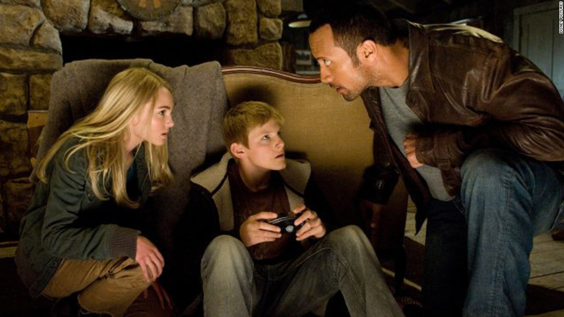 "Johnson has successfully mixed action flicks with Disney movies such as the 2009 remake of ""Race to Witch Mountain,"" here with AnnaSophia Robb and Alexander Ludwig. His cab driver role even sparked a meme."
