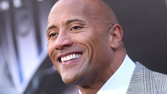 """Many claim to be the """"hardest-working man in show business,"""" but few walk the walk like Dwayne Johnson. The man with the big guns and the million-watt smile has come a long way from his days as wrestling superstar The Rock. Here are some highlights from his career."""