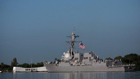 The USS Chafee does a Pass-in-review of the Arizona Memorial on the 69th anniversary of the attack on the U.S. naval base at Pearl Harbor on the island of Oahu on December 7, 2010.
