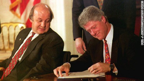 James Brady, left, the Reagan administration press secretary who was wounded during the 1981 attempted assassination of then President Ronald Reagan, watches as President Bill Clinton signs the Brady Bill at the White House.