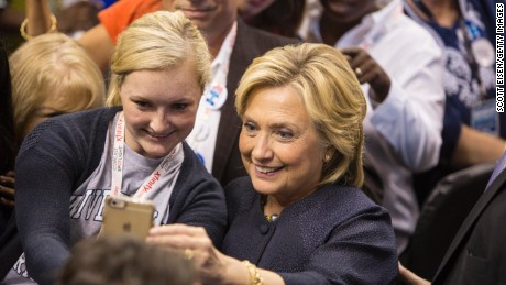 Democratic presidential candidate Hillary Clinton takes a selfie with a supporter during the New Hampshire Democratic Party Convention at the Verizon Wireless Center on September 19, 2015 in Manchester, New Hampshire.