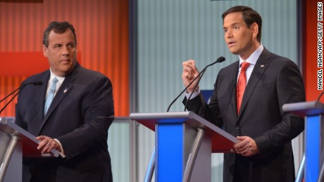 New Jersey Governor Chris Christie listens to Florida Senator Marco Rubio during the Republican presidential primary debate on August 6, 2015 in Cleveland, Ohio.