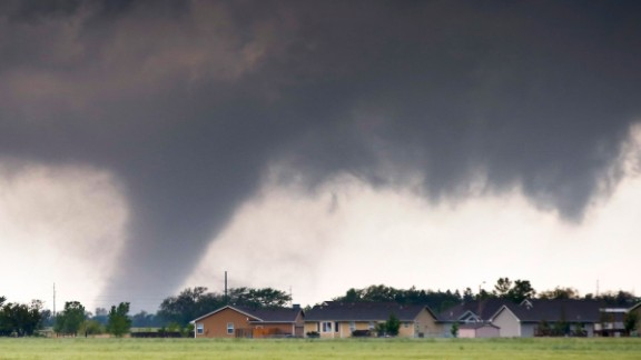A large tornado passes just to the west of Halstead, Kansas, on May 6. As many as 178 tornadoes were reported across nine states from May 6-10.  The month of May sees more tornadoes than any other month in the United States.